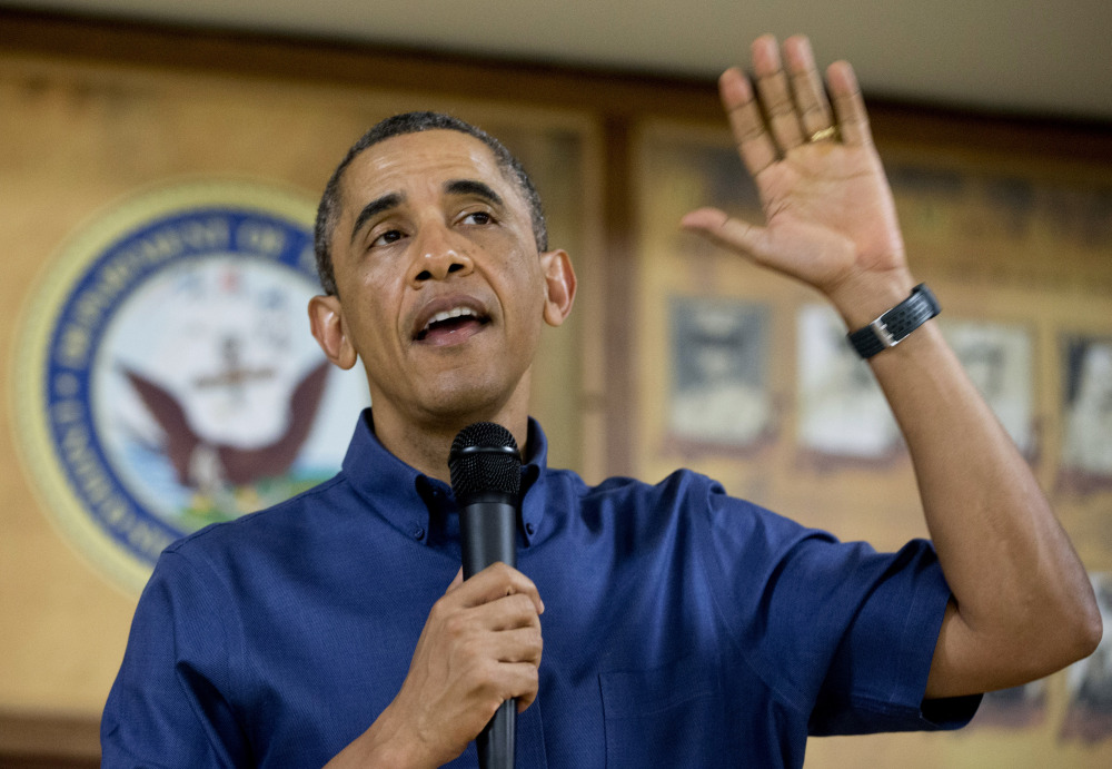 President Barack Obama speaks to members of the military and their families in Anderson Hall at Marine Corps Base Hawaii, on Wednesday in Kaneohe Bay, Hawaii. Obama signed the budget deal in Hawaii, where he spent the holiday with his family.