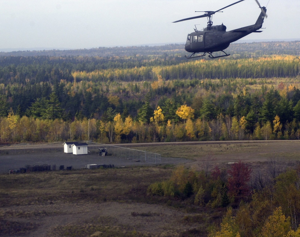 A Maine Army National Guard helicopter flies over Canadian Forces Base Gagetown in New Brunswick.