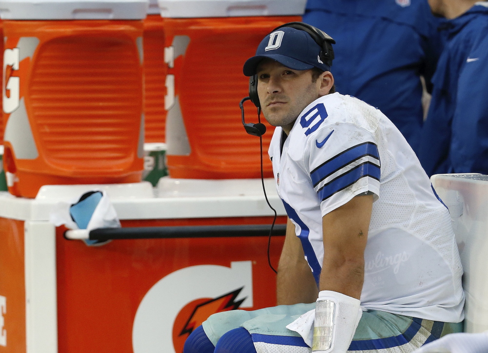 Dallas Cowboys quarterback Tony Romo sits on the bench during the second half of an NFL football game against the Washington Redskins in Landover, Md., Sunday, Dec. 22, 2013. Coach Jason Garrett said Romo had back surgery Friday, and Kyle Orton will start when Dallas faces Philadelphia on Sunday night with the NFC East title and a postseason berth on the line.