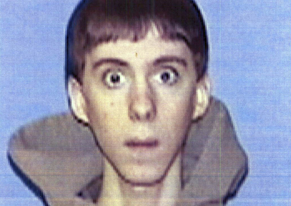 FILE - This undated identification file photo provided Wednesday, April 3, 2013, by Western Connecticut State University in Danbury, Conn., shows former student Adam Lanza, who authorities said opened fire inside the Sandy Hook Elementary School in Newtown, Conn., on Friday, Dec. 14, 2012, killing 26 students and educators. State police said their report from the investigation into last year's Newtown school massacre will be released at 3 p.m. Friday, Dec. 27, 2013. (AP Photo/Western Connecticut State University, File)
