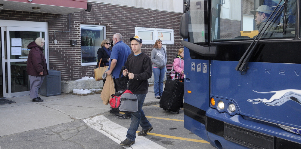 Closed: A Greyhound bus drops off and picks up customers Dec. 4 at the station at the Augusta State Airport. Greyhound Lines, which closed the station Dec. 20, is looking to open in a new location in the city.