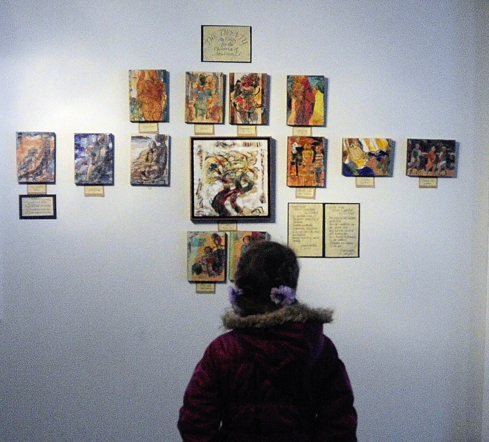 "A CHILD""S VIEW: Maya Kucharski, 9, of Sidney, looks at the art display on Sunday December 29, 2013 in the Alexander Nevsky Parish Hall, 28 Kimball St., in Richmond."