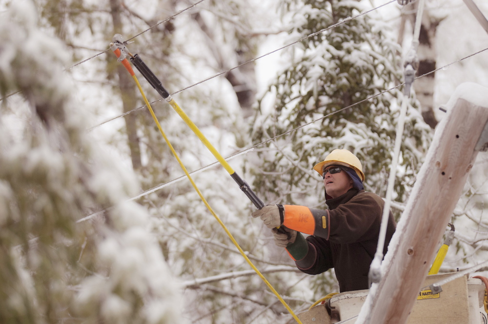 Maine Public Service lineman Craig Hobbs works to restore power in Orrington on Sunday.