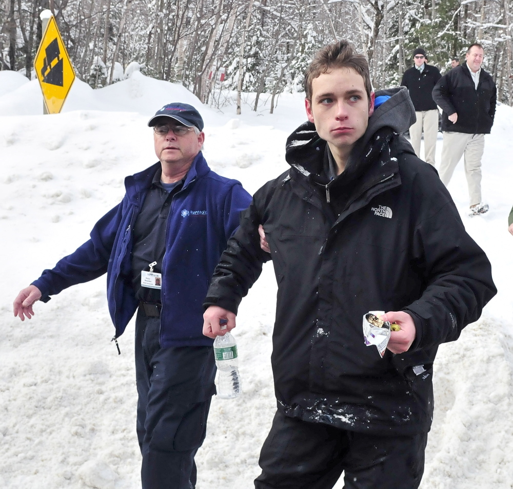 Missing skier: Nicholas Joy, 17, of Medford, Mass., is led to an ambulance in March after spending two nights lost near Sugaloaf ski area.