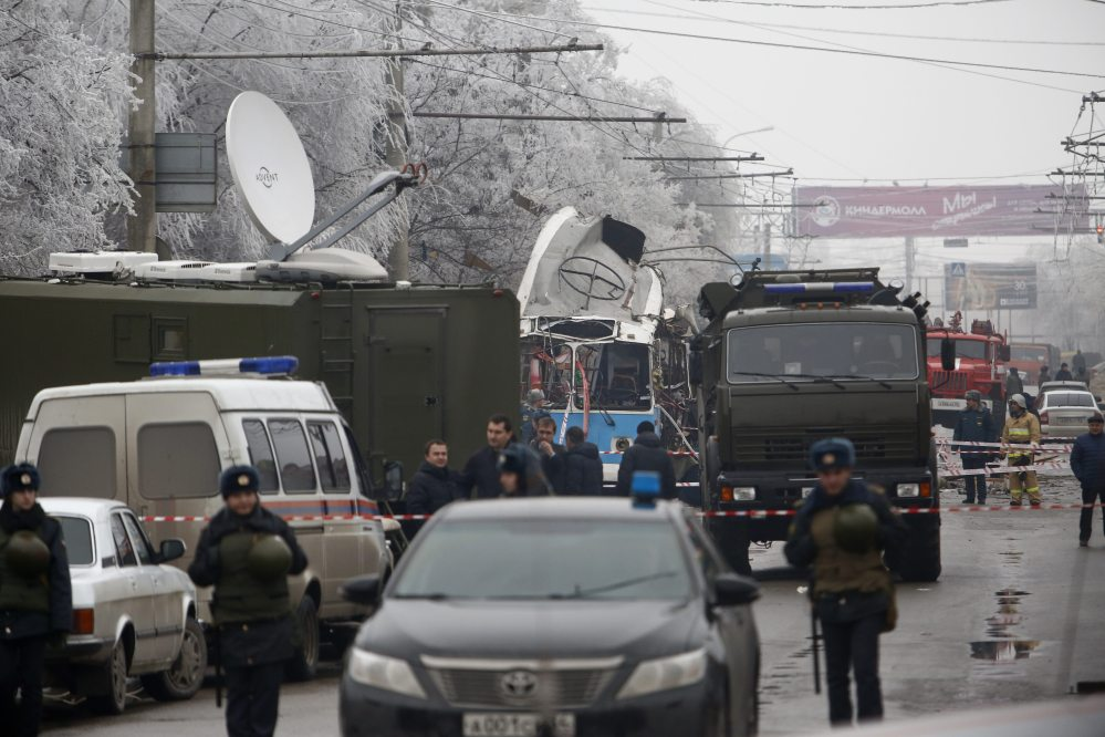 Military vehicles surround a wreckage of a trolleybus, in Volgograd, Russia, Monday.