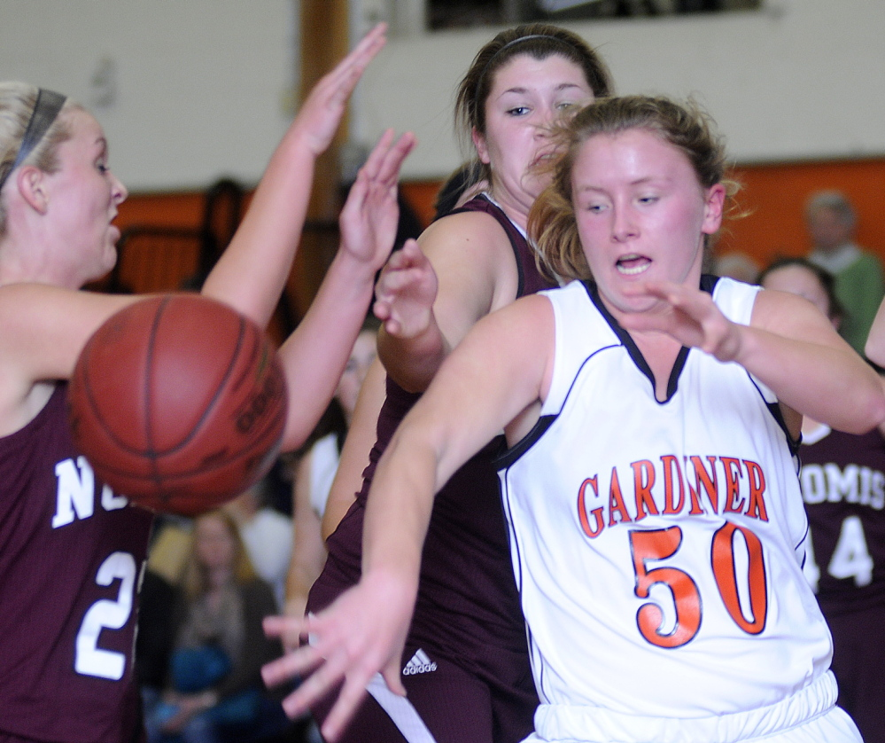Staff photo by Andy Molloy Gardiner Area High School's Camden Cone, right, chases a rebound through a wall of Nokomis High School defenders during a basketball match Monday in Gardiner.