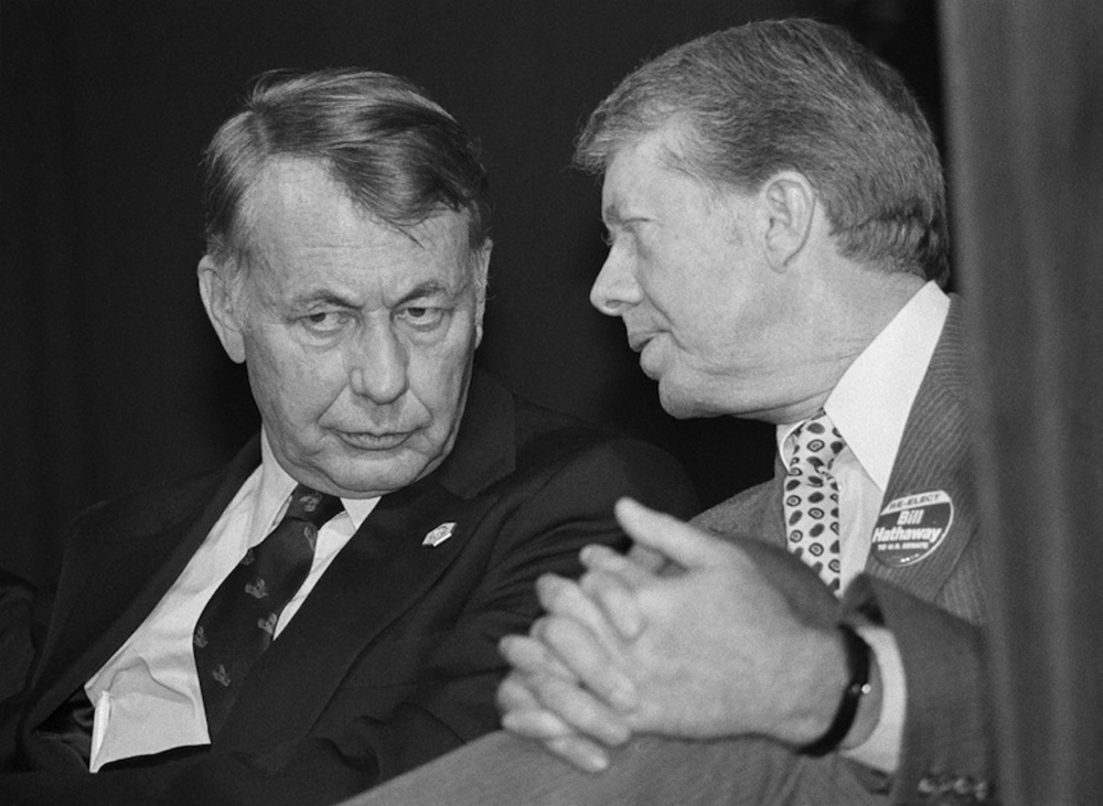 President Jimmy Carter, right, talks with Sen. William D. Hathaway of Maine as Carter wears a Hathaway button at a fundraising dinner in Portland on Oct. 29, 1978.