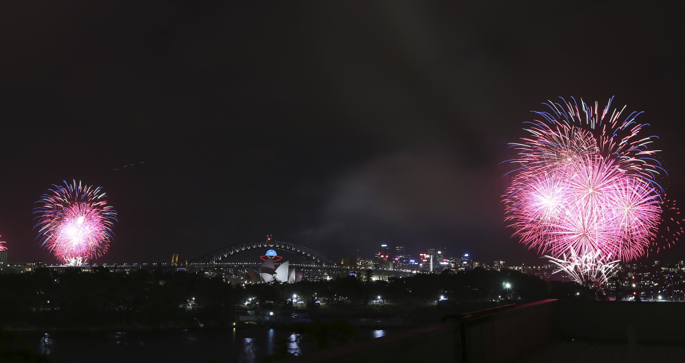 Fireworks explode near the Harbor Bridge and the Opera House during New Year's Eve celebrations in Sydney, Australia, Tuesday, Dec. 31, 2013.