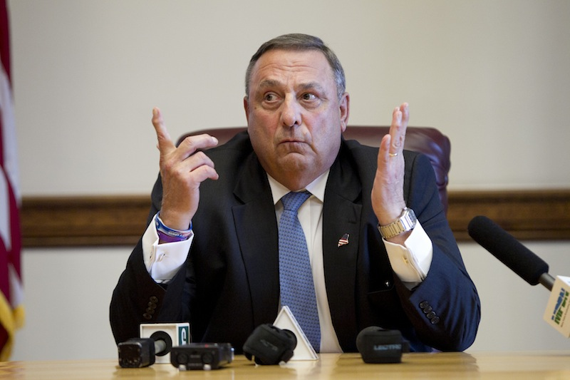 In this June 2013 file photo, Gov. Paul LePage speaks to reporters at the State House in Augusta. The LePage administration has proposed a rule change to prevent asylum seekers and some other immigrants from receiving General Assistance.