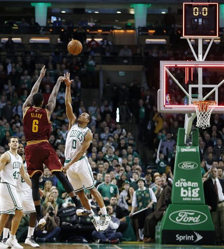 Cleveland Cavaliers' Earl Clark fails to make a 3-pointer over Boston Celtics' Avery Bradley with no time left on the clock in the fourth quarter of Saturday's game in Boston. The Celtics won 103-100.