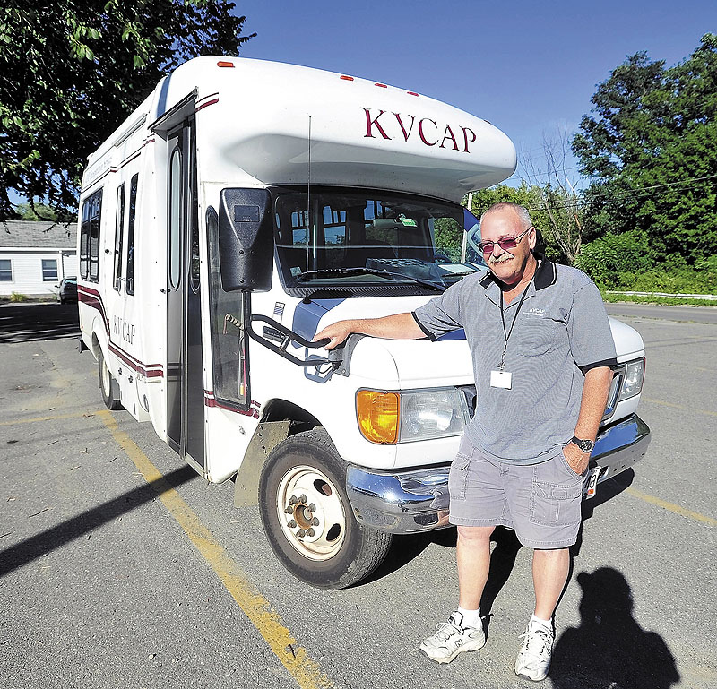 Mark Goggins stands next to his KVCAP bus in Waterville in September. KVCAP used to provide between 900 and 1,000 rides a day to MaineCare patients.