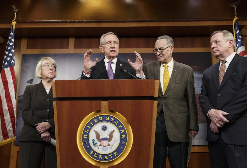 From left, Sen. Patty Murray, D-Wash., chair of the Senate Budget Committee, Senate Majority Leader Harry Reid, D-Nev., Sen. Chuck Schumer, D-N.Y., and Senate Majority Whip Dick Durbin, D-Ill., talk to reporters Thursday about the final work of the Senate as their legislative year nears to a close, at the Capitol in Washington. Reid promises a vote no later than Jan. 7 on a measure to extend jobless benefits for three months. He said the number of jobless people out of work for more than six months is far greater than in past economic recoveries.