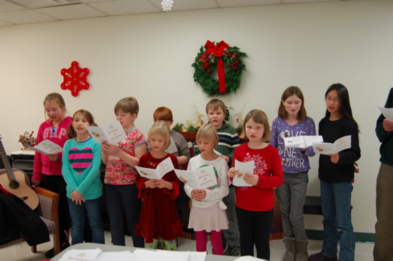 """Students in the Maine French Heritage Learning Program recently sang Christmas carols at Chateau Cushnoc in Augusta. Front, from left, are Morgan Bersani, Jasmine Day, Phoebe Norman, Chloe Schueman, Alina Schueman and Allison Foust, and back, from left, are Andrew Fortunato, Jackson Tirrell, Hannah Foust and Sarah Foust. The students sang holiday classics such as """"Oh Christmas Tree"""" and """"Jingle Bells"""" in French and other songs."""