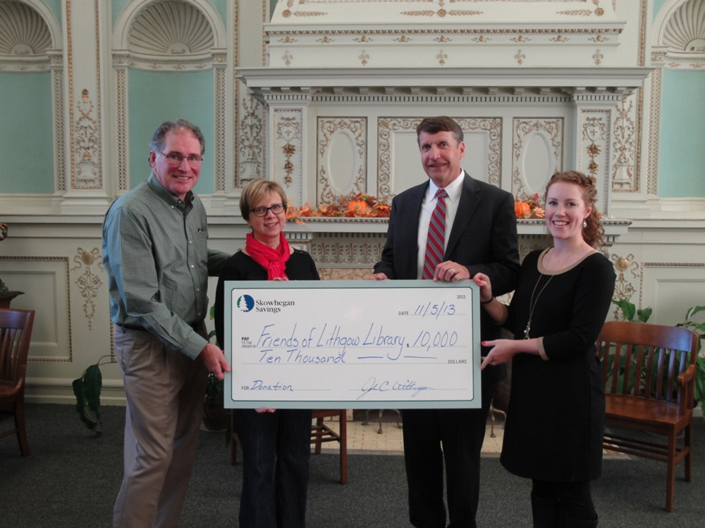 Skowhegan Savings has awarded a $10,000 gift to Friends of Lithgow Library, Inc., an organization that supports Augusta's historic Lithgow Public Library and Reading Room. Its latest campaign is to fund, along with the city of Augusta, a renovation and expansion project that will preserve the 1896-structure and include the construction of an addition that will more than double the library's functional space, with additional space for children's reading and learning activities as well as a dedicated space for teens. From left are Wick Johnson, co-chairman of the Capital Campaign; Elizabeth Pohl, library director; John Witherspoon, Skowhegan Savings president and chief executive officer; and Meghan Loubier, manager of the bank's Augusta branch. The next Capital Campaign fundraiser will be a pie sale from 9 a.m. to 6 p.m. Thursday, Jan. 23, at the library. There will be a variety of homemade pies, including apple, pumpkin, pecan, chocolate cream and blueberry.