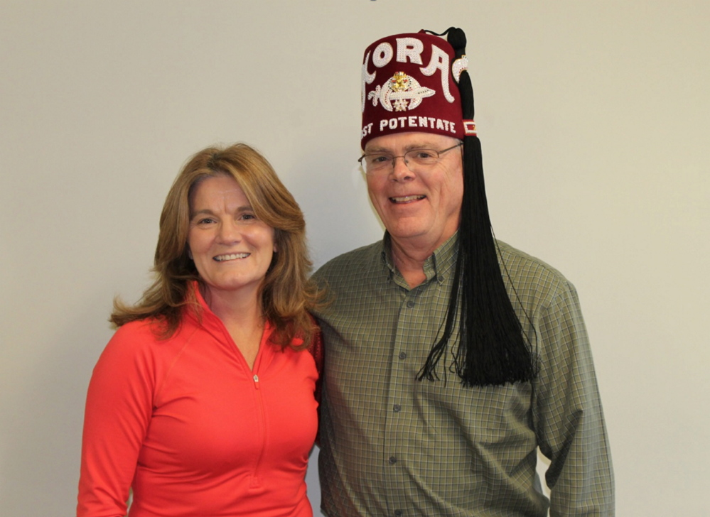 Nancy Feeney, of Fayette, has qualified for and will run in the Boston Marathon on April 21. She will also be part of the Shriners Hospital for Children Boston — Team Love to the Rescue, and will be raising money for this cause. She will wear a Shriners Hospital for Children racing bib during her run. Kenney, left, is pictured with Barry Gates, past potentate of Kora Shrine and a member of the Board of Governors of Shriners Hospital for Children — Boston, who will assist Kenney with her fundraising efforts. For more information or to make a donation, call 782-6831 or visit www.crowdrise.com/nancyfeeney#projects.