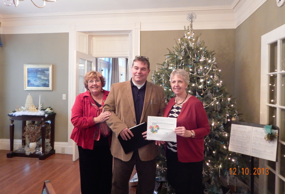 Jeffrey Johnson, executive director of the Children's Center in Augusta, presents the Garden Therapy Committee of the Kennebec Valley Garden Club with the Children's Champion Nominee Award for 2013 at a Holiday Tea event held recently at the Blaine House in Augusta. From left is Karen Foster, the club's president, Johnson, and Nancy Voisine, first vice president and committee chairman. The club's Garden Therapy Committee has spent time over the past few summers working in the Butterfly Garden and the raised bed Sensory Garden at the Children's Center as one of their projects.