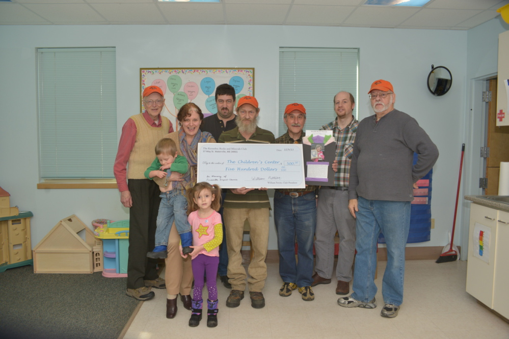 The Kennebec Rocks and Minerals Club recently donated $500 to the Children's Center in Augusta. From left are Vladimer Reneyske, club liaison; Elizabeth Barron, the center's director of development; Paul Pinette, the club's first vice president; Bill Pettitt, club president; Peter Serrada, club secretary; Stacy Morang, the club's second vice president; and Ron LePage, club treasurer.