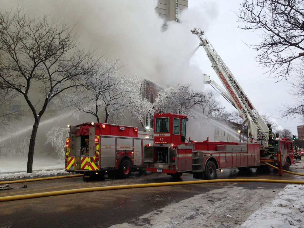 Firefighters work the scene where a fire engulfed several apartment units in the Cedar Riverside neighborhood, in Minneapolis, Wednesday, Jan. 1, 2014. Authorities say at least 13 people have been hurt.