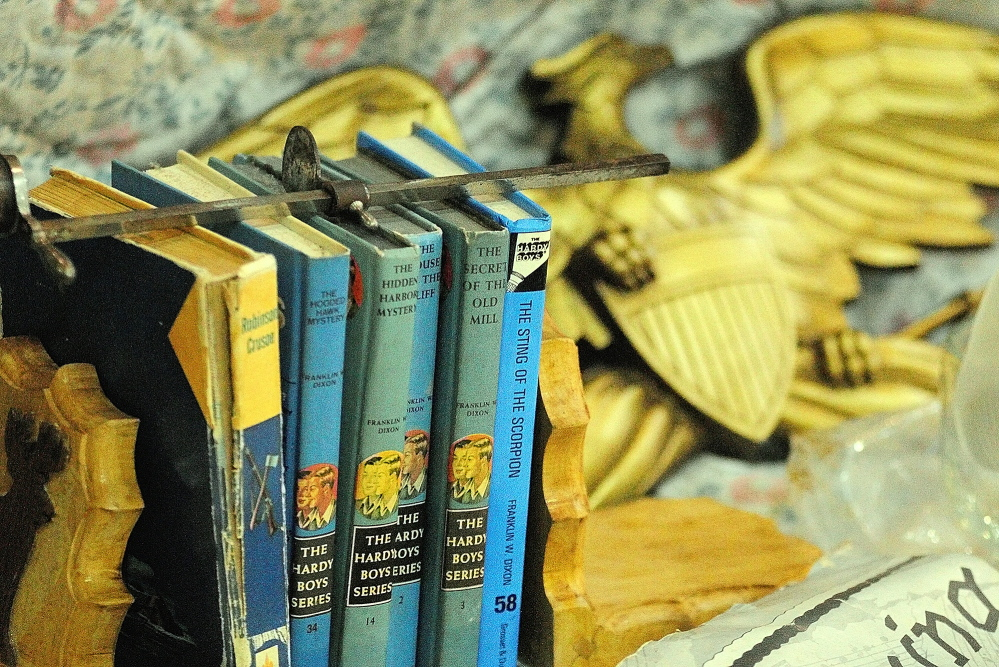 BOOK VALUE: These Hardy Boys books were among the items on sale Wednesday during the New Year's Antiques Show at the Augusta State Armory.