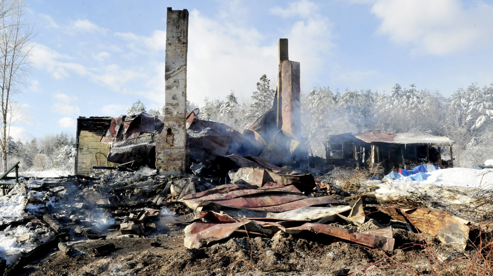 GONE: The remains of this home were still smoldering on Wednesday after fire destroyed the home late Tuesday evening on Hutchins Road in Fairfield, leaving two people homeless. Fire officials think the fire might have started near the chimney and said it is not considered suspicious.