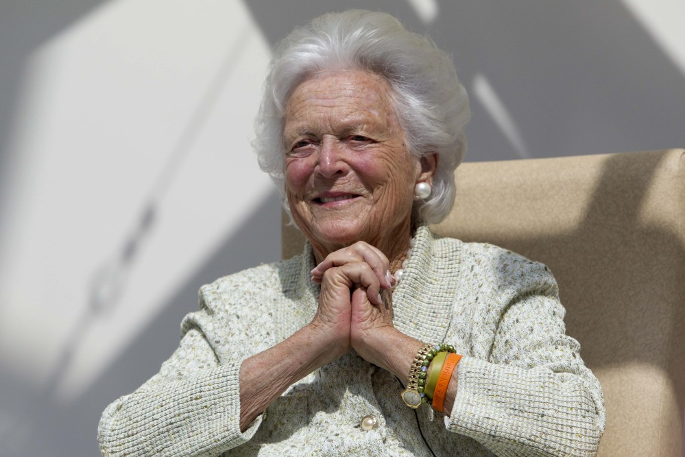 Former first lady Barbara Bush listens to a patient's question during a visit to the Barbara Bush Children's Hospital at Maine Medical Center in Portland in August.