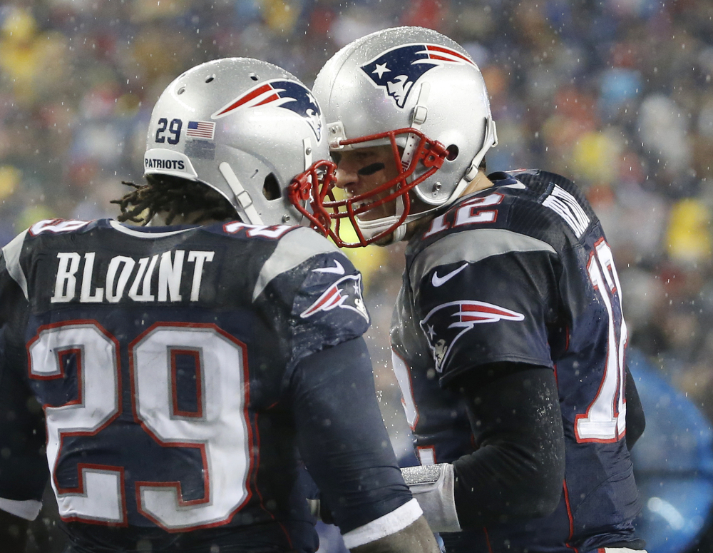 New England Patriots running back LeGarrette Blount (29) celebrates his touchdown with quarterback Tom Brady, right, in the second quarter of an NFL football game against the Buffalo Bills, Sunday, Dec. 29, 2013, in Foxborough, Mass. (AP Photo/Elise Amendola)