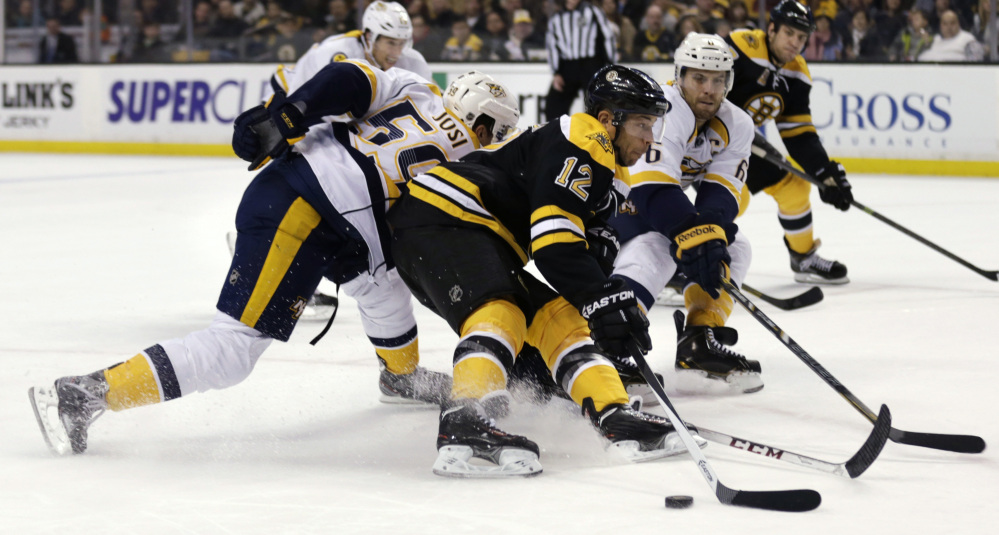 AP photo Boston Bruins right wing Jarome Iginla (12) skates past Nashville Predators defenseman Roman Josi, left, as defenseman Shea Weber (6) tries to poke the puck away during the second period of Thursday in Boston.