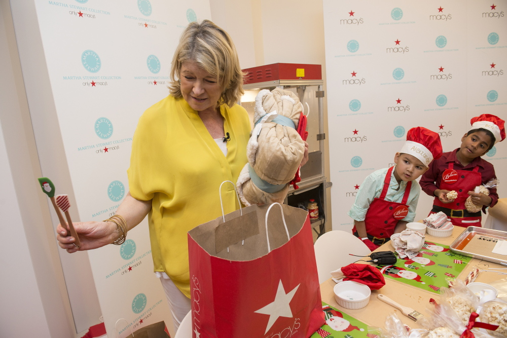 Martha Stewart presents gifts with local Make-A-Wish children at a Macy's store in Miami in celebration of the retailer's annual Believe campaign last month. Macy's has settled a contract dispute with Stewart's company.