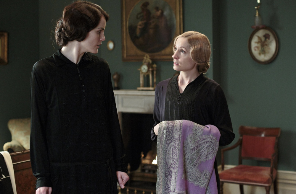 """Michelle Dockery as Lady Mary, left, and Joanne Froggatt as Anna Bates appear in a scene from Season 4 of the Masterpiece TV series, """"Downton Abbey."""" Its much-awaited fourth season premieres Sunday."""