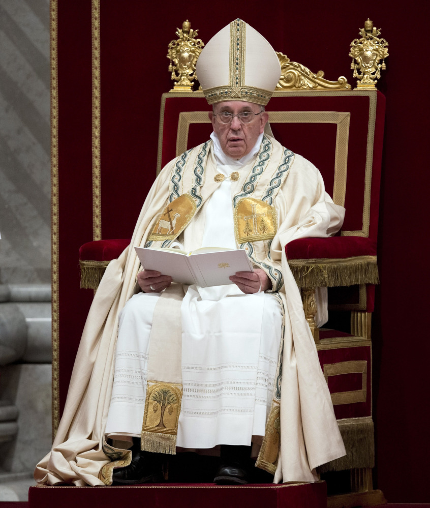 Pope Francis celebrates a New Year's Eve vespers service in St. Peter's Basilica at the Vatican. AP Photo