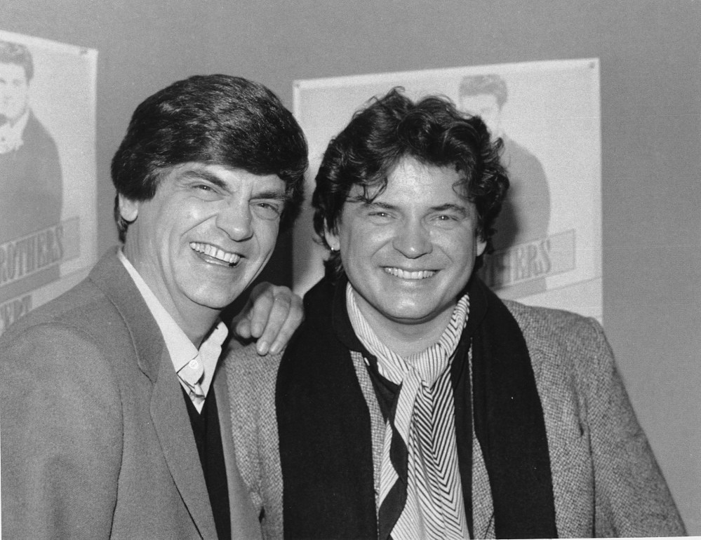 Phil, left, and Don Everly of the Everly Brothers joke around for photographers on Jan. 4, 1984, in New York City.