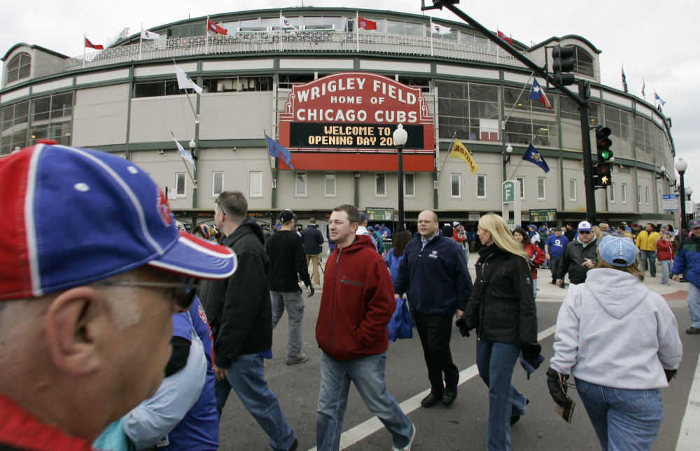Chicago Cubs fans gather on an opening day outside Wrigley Field in Chicago. AP Photo