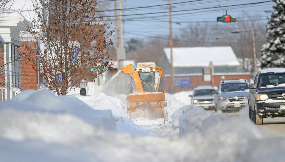 SIDEWALK WORK: The Waterville Public Works clears the sidewalk on Pleasant Street in Waterville on Friday.