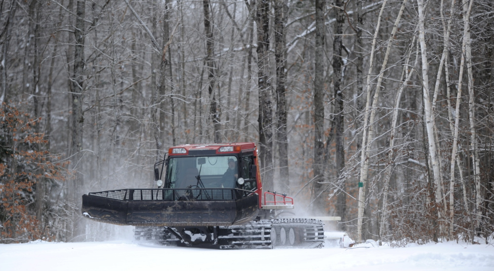 DEEP FREEZE: One place where an abundance of snow isn't a problem is the Quarry Road Recreational Area, where a grooming machine was tending to cross country trails there Friday.