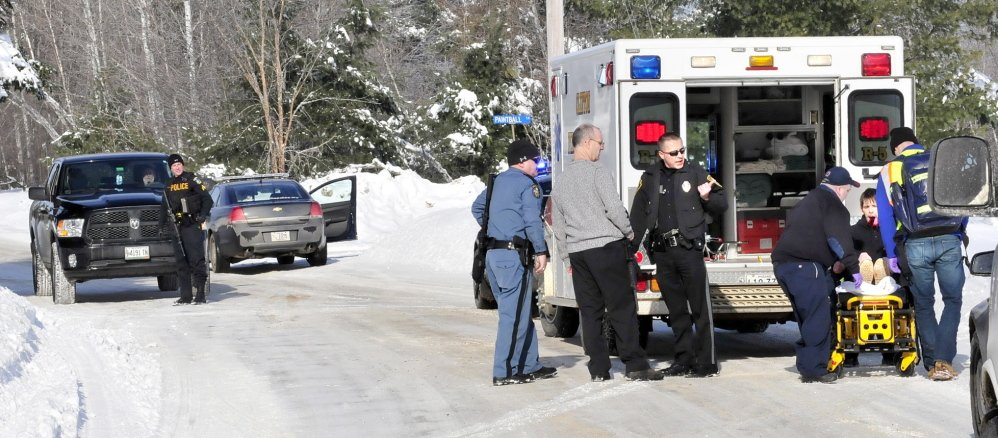 SELF INFLICTED: A man is loaded into an ambulance with injuries to his face that police say was self inflicted following a domestic dispute with a women at a residence on the Horseback Road in Clinton on Sunday, Jan. 5, 2014. Police from several agencies including Clinton, Waterville, State Police and Kennebec Sheriff Office responded. The woman was transported by ambulance as a precaution.