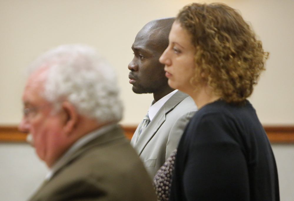 Eric Gwaro listens to Justice Joyce Wheeler sentence Gwaro to eight years in prison for his attack on Sherri York in 2012 during his sentencing at Cumberland County Unified Criminal Court in Portland on Monday, Janaury 6, 2014. With Gwaro are his attorneys Daniel Lilley, left, and Tina Nadeau.