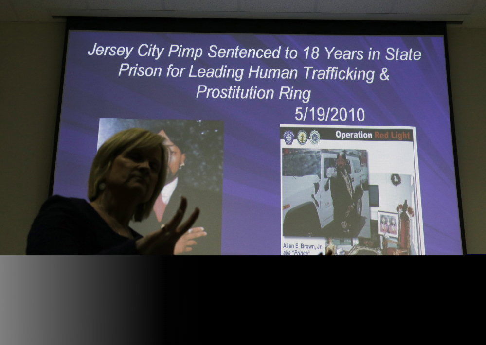 Kathleen Friess gives a presentation recently on human trafficking for hotel and nightclub employees and tries to dispel notions of what human trafficking looks like. Often, Friess said, it's a local woman forced into sex work by a man she initially thought had romantic intentions.