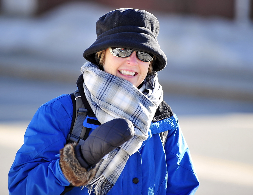 Dressed for the cold weather, Rhonda Grigg heads for some downton shopping as she walks from the Eastern Prom to Congress Street on Tuesday.