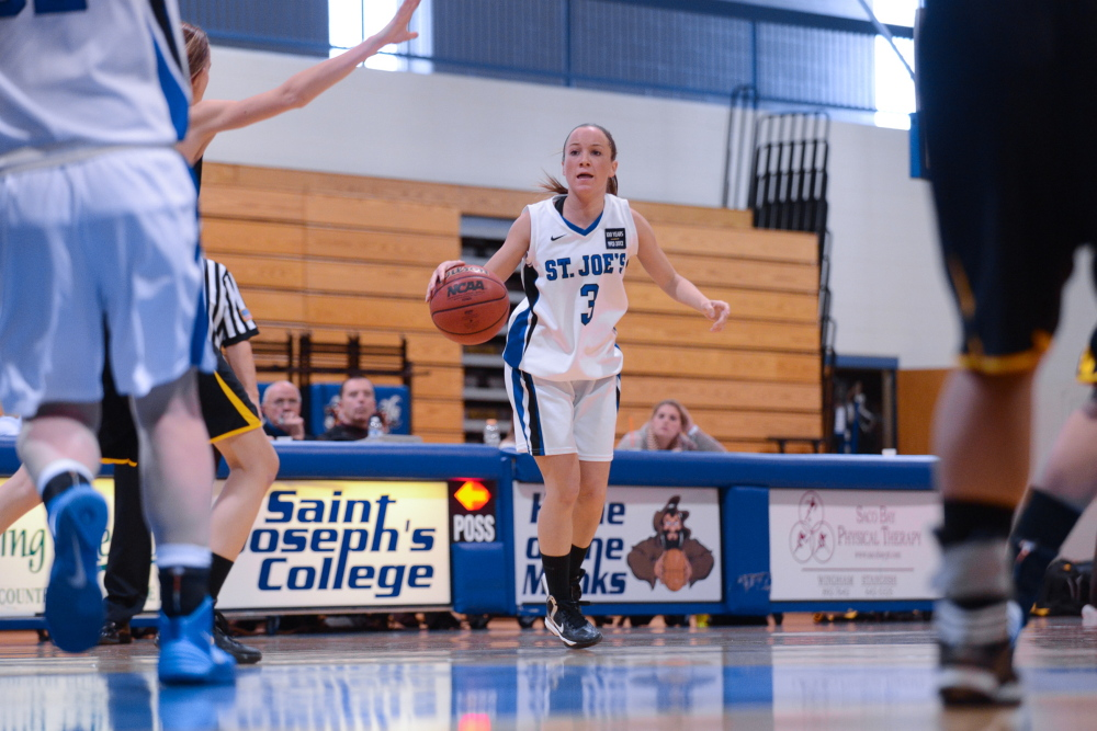 PLAYING A KEY ROLE: Cony High School graduate Mackenzie Dufour has played a key role for the St. Joseph's women's basketball team this season. Dufour, a four-year starter at point guard, has helped the Monks start 7-3 this season.