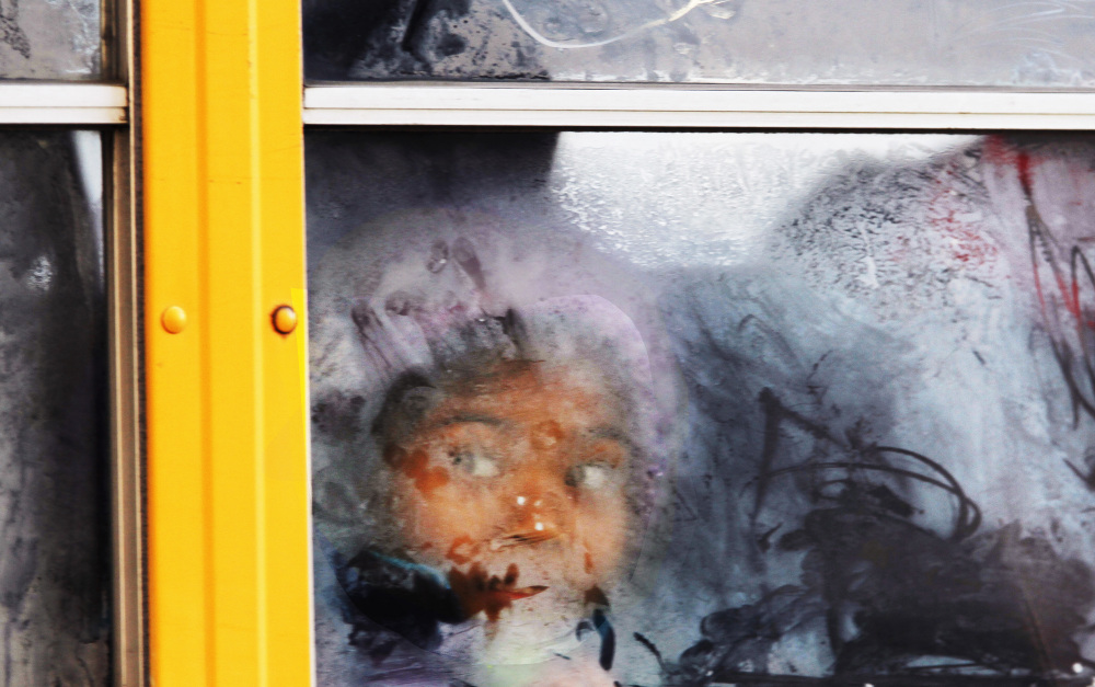 A student looks out the frosted window of a school bus as it moves down 19th Street, Tuesday, Jan. 7, 2014 in Philadelphia. The record-breaking polar air that has made the Midwest shiver over the past few days spread to the East and South on Tuesday, sending the mercury plunging into the single digits and teens from Boston and New York to Atlanta, Birmingham, Nashville and Little Rock _ places where many people don't know the first thing about extreme cold.
