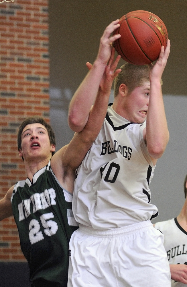 Staff photo by Joe Phelan Winthrop's Dakota Carter, left, and Hall-Dale's Brian Allen go up for a rebound during a game on Tuesday January 7, 2014 in the Penny Memorial Gymnasium at Hall-Dale High School in Farmingdale.