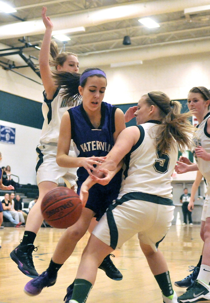 Staff photo by Michael G. Seamans FIGHT FOR IT: : Mt. View High School defenders Courtney Morse, right, and Ashlee Spaulding, 55, left, battle with Waterville's Fotini Shanos on Tuesday at Mt. View High School in Thorndike on Tuesday.