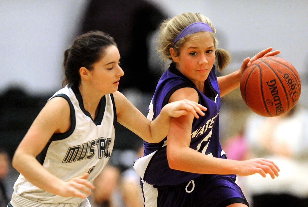 Staff photo by Michael G. Seamans ON THE WAY TO VICTORY: Mt. View's Morgan Clifford, left, defends Waterville's Colleen O'Donnell in the second half Tuesday at Mt. View High School in Thorndike. O'Donnell had 22 points and 12 steals and the Panthers won 53-39.