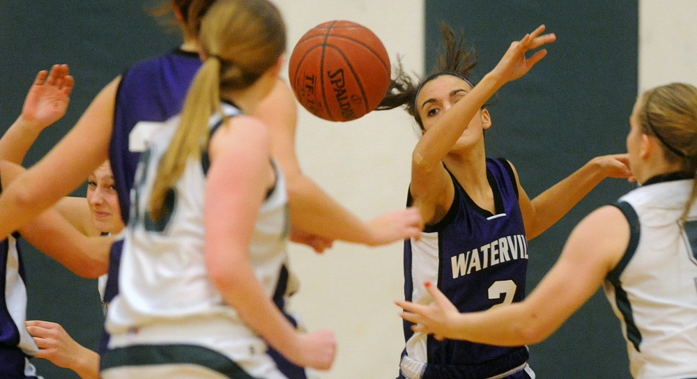 Staff photo by Michael G. Seamans HIGH SCHOOL BASKETBALL: Waterville Senior High School's Jordan Jabar, 2, swats at the ball for the rebound at Mt. View High School in Thorndike on Tuesday.