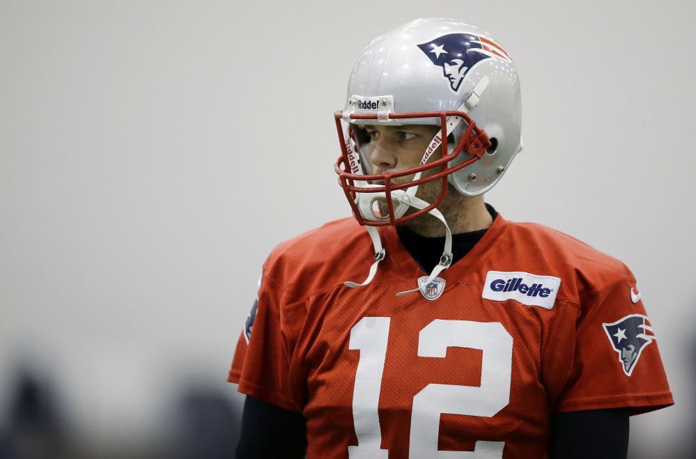 New England Patriots quarterback Tom Brady pauses during a stretching session before practice Tuesday at the team's facility in Foxborough, Mass. The Patriots are scheduled to host the Indianapolis Colts in an NFL divisional playoff game on Saturday.