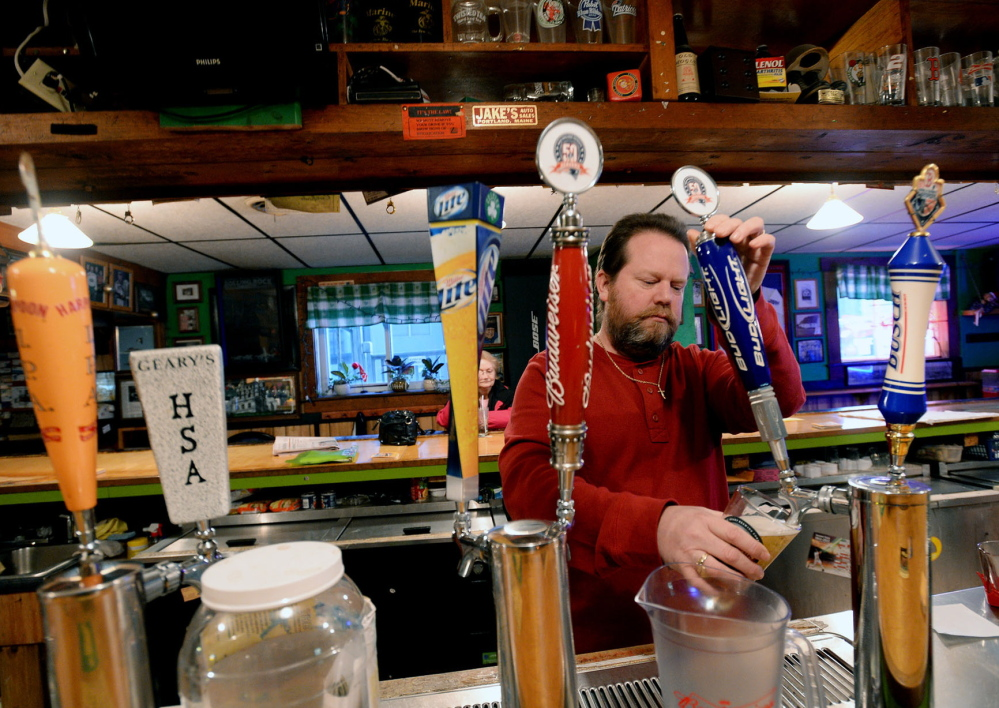 At top, a Portland man uses a food stamp card to buy groceries in 2008. Above, Scott Parker, owner of the Griffin Club in South Portland, pours a beer Tuesday. His club was one of many establishments where misuse of EBT cards may have occurred, according to transaction data released by the LePage administration. Parker said his business accepts cash only, but has an ATM inside where an EBT card can be used. He said people shouldn't buy alcohol and cigarettes with their welfare cards, but there's no way for him to track when it's happening at his club.