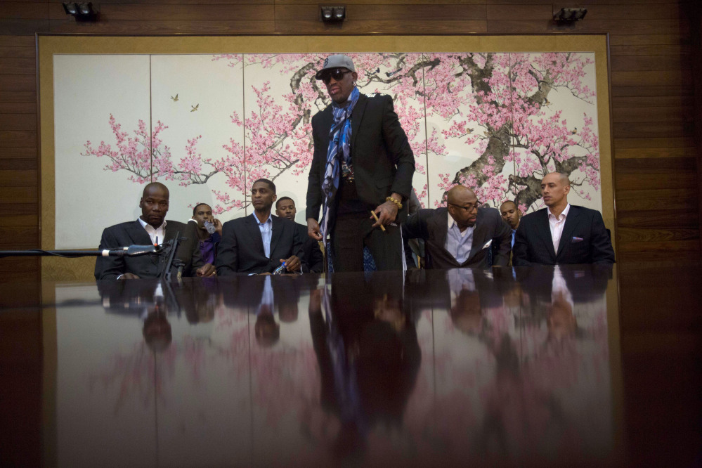 Dennis Rodman stands up to leave after he and fellow US basketball players completed a television interview at a Pyongyang, North Korea hotel Tuesday.
