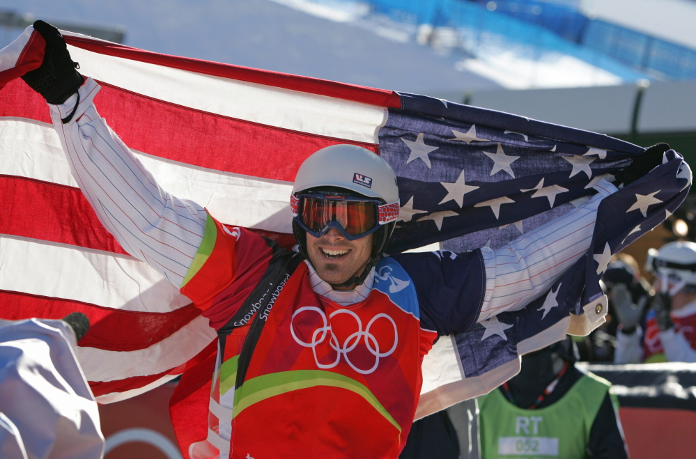 Two-time gold medalist Seth Wescott reacts after his race in the final of the snowboard cross competition at the Turin 2006 Winter Olympic Games.