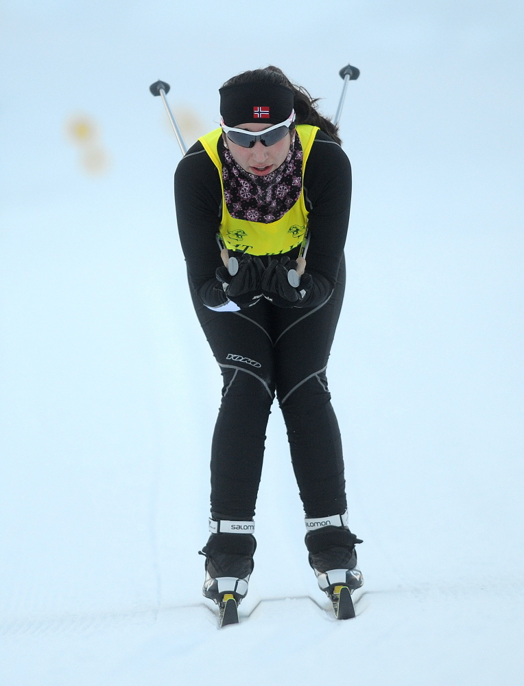 Staff photo by Michael G. Seamans COUGAR CLASSIC: Kents Hill High School's Aimee Sala tucks through the final stretch to finish second at the Cougar Classic nordic ski meet at Titcomb Mountain in Farmington on Wednesday.