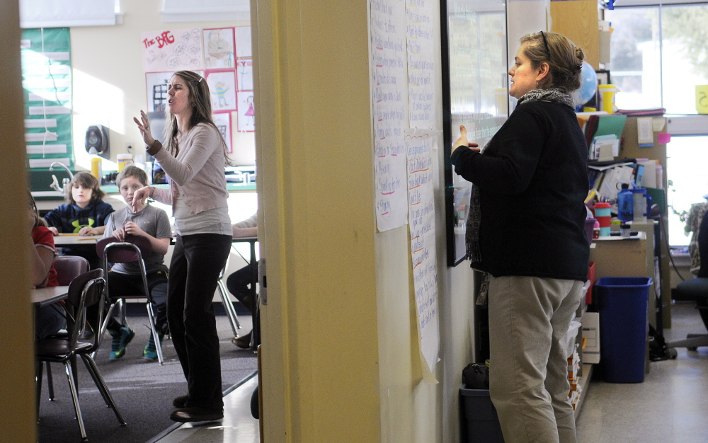 SQUEEZE: Fourth grade teachers Gretchen Nickerson, left, and Sarah Hanley instruct in a room at the Helen Thompson School in West Gardiner that is divided by a temporary wall. Nickerson teaches in the former life skills space while Hanley uses the former art studio for their classrooms.